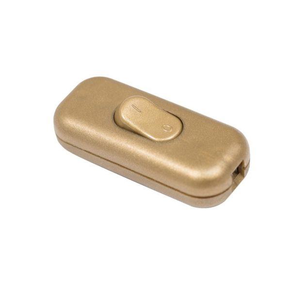 Vypínač na svietidlá v zlatej farbe